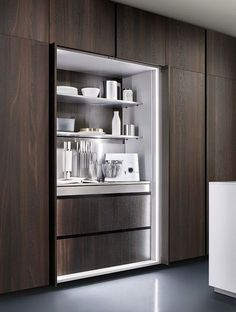 """For the study cupboards - like the way the full height doors slide around to the side. So, we can have a """"work station"""" hidden inside the doors. Note: Not this timber colour."""