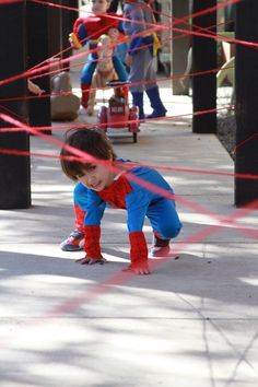 Great idea for a party game at superhero themed party. Use red yarn and create a laser maze. Attach little bells. Aim of game, get through the lasers without the bells ringing
