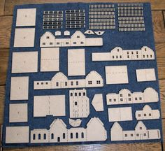 This is a Putz House kit consisting of 6 chipboard buildings that you assemble and decorate. I have included pictures of some finished sets for Christmas Village Houses, Putz Houses, Christmas Villages, Saltbox Houses, Noel Christmas, Christmas Paper, Christmas Crafts, Christmas Decorations, Cardboard Crafts