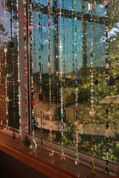 Love it - beaded Boho window style. I'm afraid kitties would like it too ... ;)