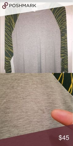 Lularoe Randy Baseball Tee 2xl Green Bay Packers Excellent, like new condition. Small discoloration in the Heather Gray but I believe it was made like that. Colors are green and yellow, true Green Bay Packers colors! LuLaRoe Tops Tees - Long Sleeve