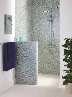 Tavo glass penny round mosaics provide a change from the standard square shape. These neutral iridescent mosaics take on colours in their surroundings, providing a serene feel that work work well in costal bathrooms. originalstyle.com