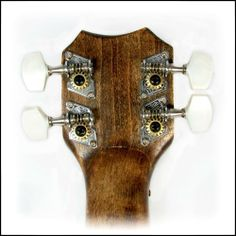 """Cigar Box Guitar Parts: Shane Speal Signature 4-String CBG Tuners by C. B. Gitty Crafter Supply. $7.49. This set of Shane Speal Signature tuners is PERFECT for first-time Cigar Box Guitar builders, since it has exactly what you need and tells you how to use it, with no leftover parts!   This is a set of 4 open-gear tuners for cigar box guitars (2L/2R alignment), identical to the type used by """"King of the Cigar Box Guitar"""" Shane Speal on his own CBGs! This set includes all o..."""