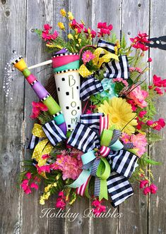 "Spring BLOOM Watering Can Grapevine Spring is in the air!! 34"" Length 24"" Width Designed on a Grapevine base Mixed spring time wild flowers of beautiful bright colors of mint blues, bright yellows, hot pink and lime greens..layered in fern greenery for fullness. Accented with"