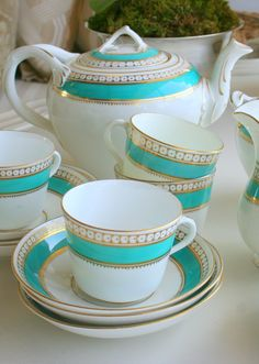 English China tea set.  Love the turquoise and white with gold accents