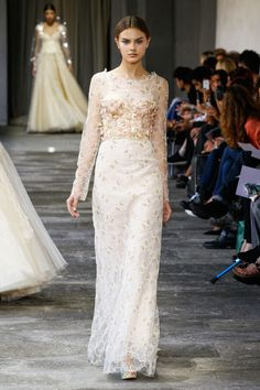 Wedding Dresses for the Fashion Obsessed: A classic neckline with fashion-forward 3D floral embellishments make this Luisa Beccaria gown a unique take on bridal wear.