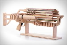 RUBBER BAND MACHINE GUN... If only this were around in architecture studio in college... I would have ruled the rubber bad wars!