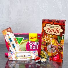 Designer Pearls Two Rakhis with Soan Roll and Rakhi Greeting Card