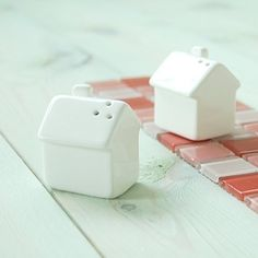 Little salt and pepper shakers in the shape of houses. Perfect for a housewarming gift!