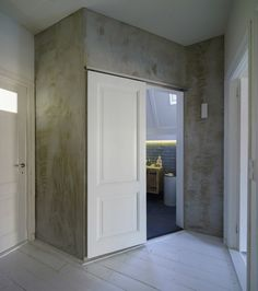 Owners of a row house built in 1900 reached out to Ruud Visser Architecten to design a modern extension on the back that resembled their neighbors. Arch Interior, Interior Design, Loft, Daughters Room, House Built, Large Windows, Home Renovation, Townhouse, Tall Cabinet Storage