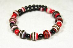 You'll make a great impression in this handmade chunky wooden choker in shades of black, gray, red and pink. $25 at #SmallestPlanet on #Etsy. Get 15% off your entire purchase with coupon code PIN15.