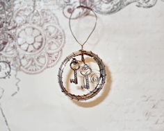 Steampunk Key and Wire Wrap Christmas Ornament. $15.00, via Etsy. I have tiny keys and hoops,pinning for inspiration
