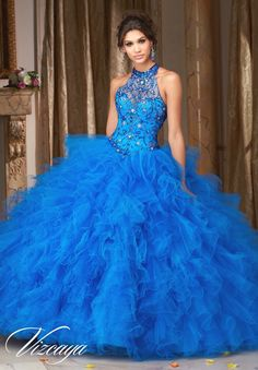 Stunning and gorgeous, Mori Lee Vizcaya Quinceanera Dress Style 89103 is sure to light up the room during any girl's Sweet 15 party. Made out of tulle, this Quince dress features a high halter sheer i