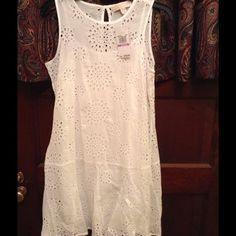 MICHAEL Michael Kors dress Sleeveless Eyelet Lace Dress. Look EYE catching in the EYELET LACE dress. Cotton and machine washable. All over eyelet lace detailing and lined. Approximate length 31 inches. Selling now at Macy's for $112 MICHAEL Michael Kors Dresses