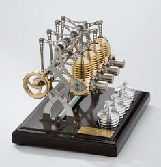 A Stirling engine is a heat engine operating by cyclic compression and expansion of air or other gas, the working fluid, at different temperature levels such that there is a net conversion of heat energy to mechanical Or more specifically, a c Motor Stirling, Stirling Engine, Rocket Engine, Rankine Cycle, Maker Shop, Steampunk Design, Small Engine, Cool Technology, Miniatures