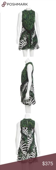 "Proenza Schouler Palm Leaf Print Silk Dress Excellent condition,  Black, white and green Proenza Schouler sleeveless silk palm leaf print mini dress with mock neck. Sarong overlay at waist with tie closure featuring contrasting print and hook-and-eye closure at nape. Bust: 32"", Waist: 32"", Hip: 36"". 100% silk. Fully lined. No flaws. Proenza Schouler Dresses Mini"