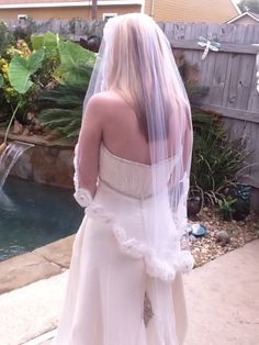 Bridal veil with large lace roses and Swarovski crystal rhinestones in each rose's center. Sold on Etsy.