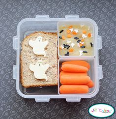 Here's a bento for her afternoon nutrition break. Half a ham and cheese sandwich with little mozza ghosts. A container of applesauce with halloween sprinkles and a container of baby carrots.