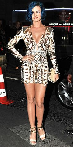 KATY PERRY  A supershort, boldly patterned Balmain mini and gold-and-cream accessories were the perfect funky complement to the singer's curled blue bob at a dinner in Paris.