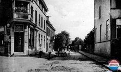 Arnhem: De Arnoudstraat, in 1910 gefotografeerd vanaf de Oude Velperweg. Links op de hoek is dan gevestigd de kruidenierswinkel van E. Kuijl.