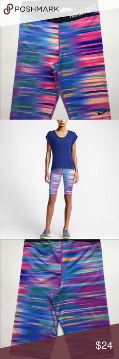 """Nike Women's 11"""" Pro Swift Training Shorts Medium Nike Women's 11"""" Pro Swift Training Shorts in vibrant multicolor. Excellent condition!!  LIKE NEW!! Nike Pants"""