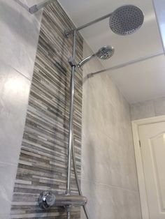 shower stalls with tile feature wall | Feature tiles can be used in conjunction with surrounding tiles and ...