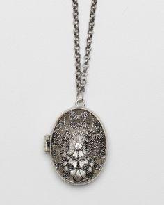 Distressed metal locket with diamond center