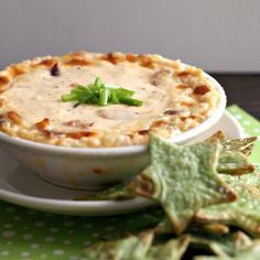 Hot and Cheesy Bacon dip with customized green chips that are easy to make.  Perfect for a St. Patty's day party or potluck.