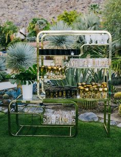 Loving the glassware display at Whitney Eve Port & Tim Rosenman's Palm Springs wedding reception at Colony Palms. Photo by Hannah Costello | Design by BK Events | Rentals/Design by Pow Wow Design Studio