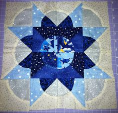 Split Drunkard's Path Star. Nice looking block. Not a great tutorial unless you have exactly the cutting and sewing machines she does.
