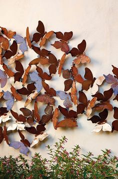 A kaleidoscope of butterflies taking flight enlivens outdoor walls and living spaces with soothing aesthetics, texture and visual appeal. Handcrafted by artist Aaron Jackson, each specimen in the Butterfly Wall Panel is interlinked and radiates in a rust patina finish. Natural weathering and aging process adds to varied coloration. Transform patios and sunrooms into blissful summertime getaways.