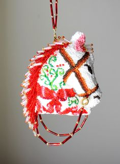 The Christmas Bow Horse ornament by Safe Harbor Boutique on Etsy.