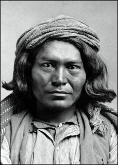 A young Apache man. Photographed between 1875 and 1879.