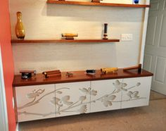 Custom routed cabinets.  Beautiful floral design.