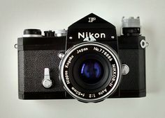 """Black Nikon F, with 50mm f/2 """"normal"""" lens. The f/2 lens and the 50 f1.8, were optically the best, but not as """"glamorous"""" as the f/1.4 and f/1.2."""