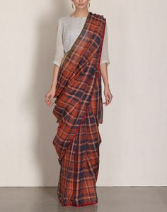 Check out our Big Plaid Saree by ANAVILA available at Ogaan Online store at special price. Anavila is known for her simple and elegant light linen saris that drape beautifully Simple Sarees, Trendy Sarees, Stylish Sarees, Indian Dresses, Indian Outfits, Indian Saris, Indian Ethnic, Modern Saree, Indian Attire