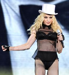 US pop singer Madonna performs on stage during her concert of the 'Sticky and Sweet' world tour at the LTU-Arena in Duesseldorf, western Germany on Thursday, Sept. 4, 2008. (AP Photo/Rene Tillmann) via @AOL_Lifestyle Read more: http://www.aol.com/article/entertainment/2017/01/10/madonna-harpers-bazaar-younger-lovers/21651935/?a_dgi=aolshare_pinterest#fullscreen