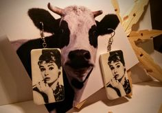 Polymer clay earrings. Even a cow can wear Audrey! Laser printer image transfer.
