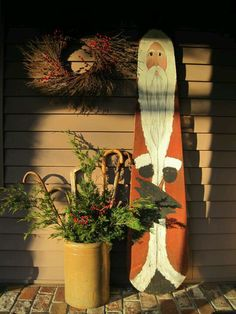 Santa painted on an old wooden ironing board- By my friend, Elsie Marie Bone Bailey- who has been featured in Country Sampler:)