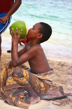 Fijian boy drinking coconut juice. Sawana, Fiji | Fiji Islands Culture + Travel Tips