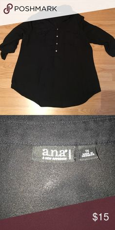 Tunic Top Black; buttons half way down; pockets on breasts; rolled sleeves; tunic length a.n.a Tops
