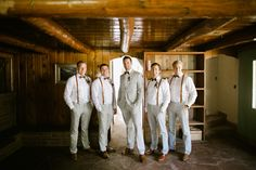 groomsmen in light gray suits