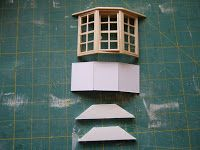 Modify commercial bay window for a window seat