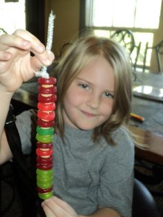 spinal cord model using gummy Life Savers and wagon wheel pasta on a pipe cleaner