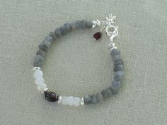 $55 Labradorite, Moonstone, Garnet and Sterling Silver Bracelet (love this but minus the toggle clasp and garnets - even though it's my birthstone; looking for something similar but not quite like this... lol)