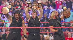 Tag Team Champions Roman Reigns and Seth Rollins and The US Champion Dean Ambrose