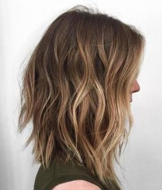 long choppy bob with light brown balayage /