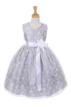 The perfect dress for her special day, this dress is so stylish. The dress is made in beautiful floral lace and the waist line is accented with an adorable bow. The skirt on this dress has the perfect amount of fullness. Comes in endless removable satin sash and pin on flower color options. The dress is fully lined for complete coverage to ensure that your princess stays comfortable. Zipper closure. Proudly made in the USA.