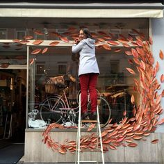 shop window displays Swirl of leaves window display by Maria Over for MILK Munich Boutique Window Displays, Store Window Displays, Autumn Window Display Retail, Halloween Window Display, Spring Window Display, Fall Store Displays, Autumn Displays, Display Windows, Shop Displays