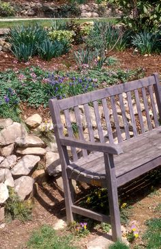 Wooden bench against retaining wall
